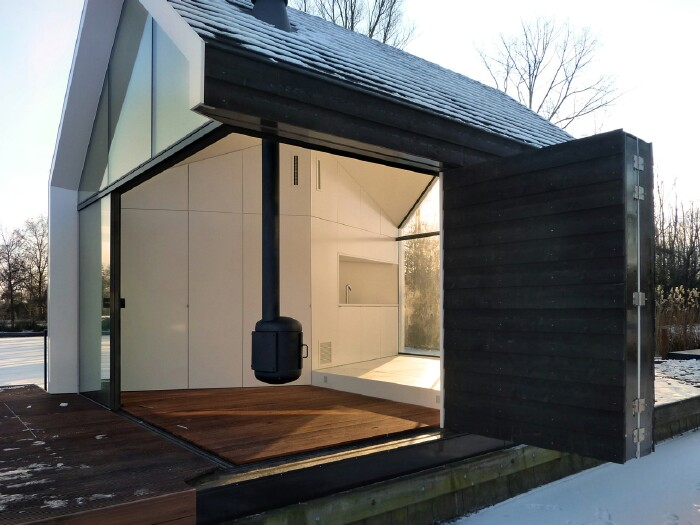This Tiny Lake House Lets You Dive In For a Swim Right From the Living Room
