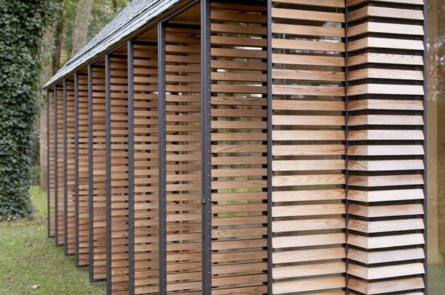 This Tiny House Features a Genius Wall of Shutters You Can Open Wide