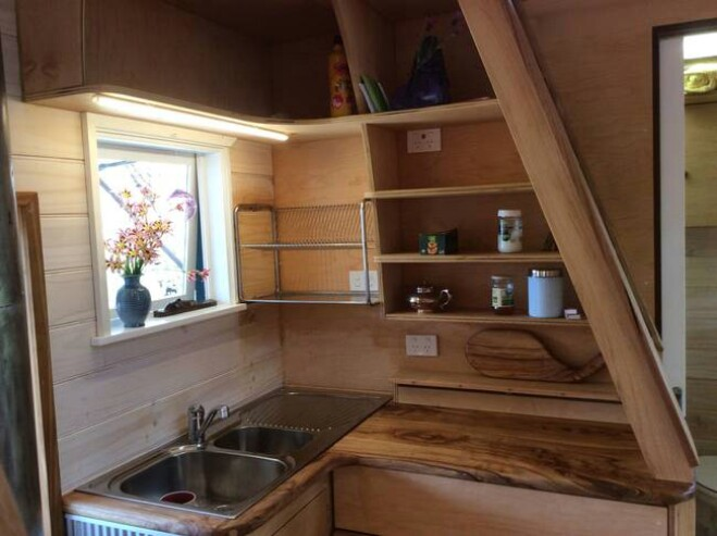 Beautifully Designed Tiny House Includes a Handmade Wood Stove 12