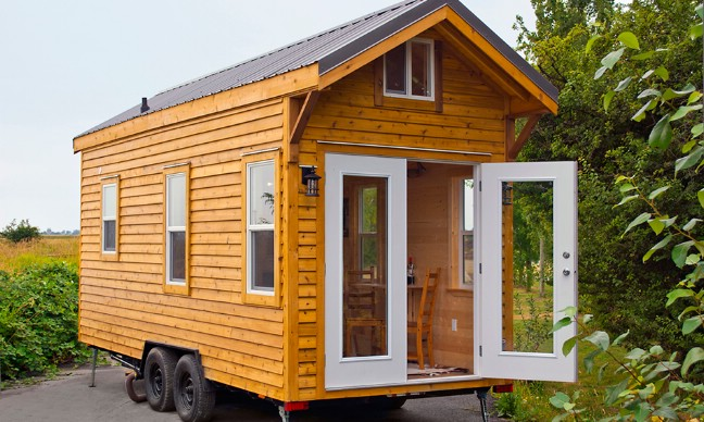 Escape to the woods in this adorable cabin by mint tiny for Tiny homes company