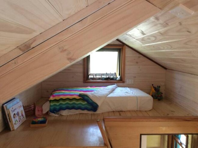 Beautifully Designed Tiny House Includes a Handmade Wood Stove