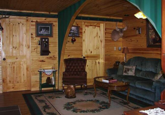 Oklahoma man makes off grid retreat from shipping for Hunting cabin bedroom