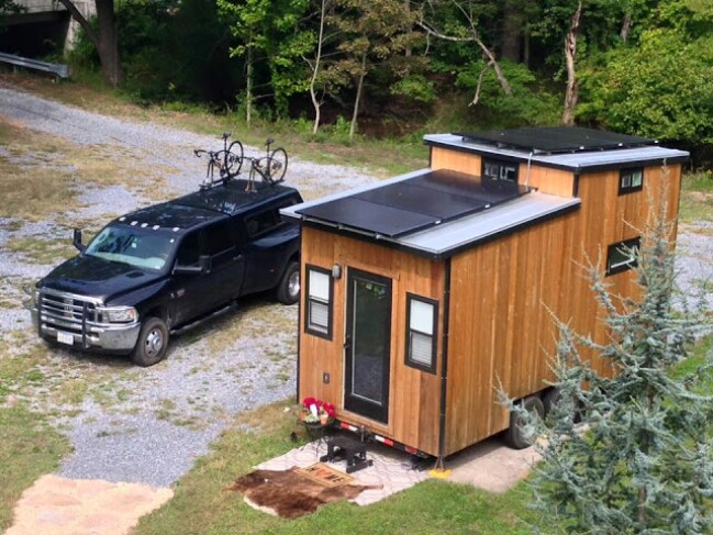this couple live off grid in their 210sf solar powered tiny house tiny houses. Black Bedroom Furniture Sets. Home Design Ideas