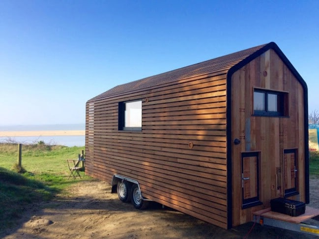 one of his latest models is called the huttopie and its a completely custom wooden beauty the exterior of the home is wrapped completely in wood with - Tiny House Builder