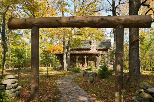 Rustic log cabin by Locati Desings