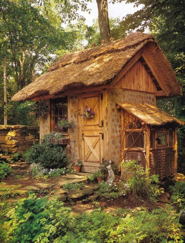 Beautiful Cordwood Shed with Thatched Roof