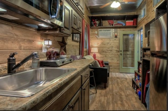 This Shipping Container was Turned into a Rustic Log Tiny House