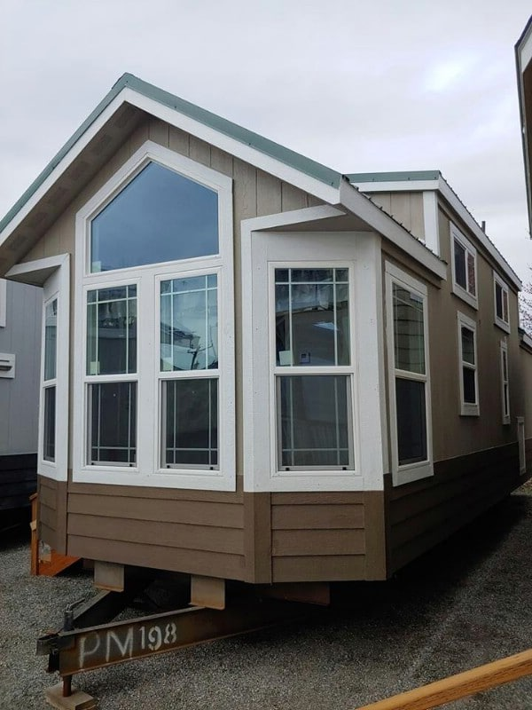 This Roomy Tiny House Features Big Windows and Plenty of Storage Space