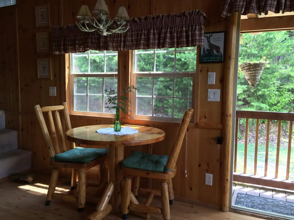 Rustic wooden dining table in cabin