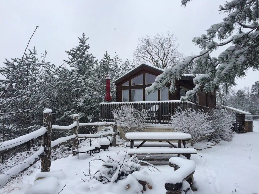 Cabin on hill in snow