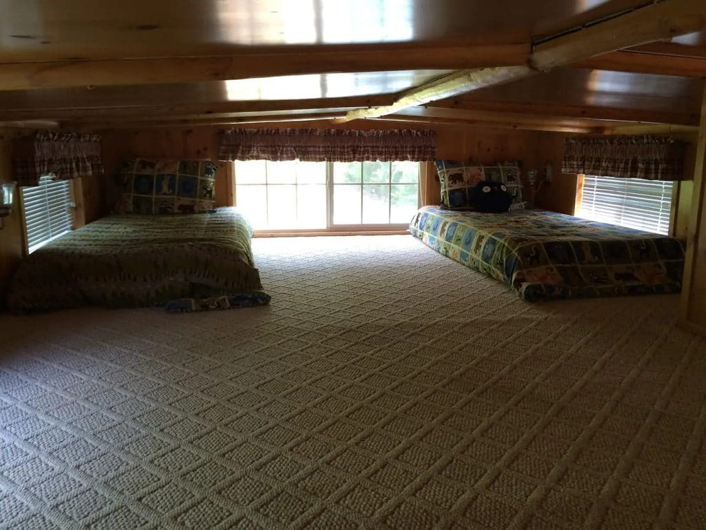 Loft sleeping space with two twin beds