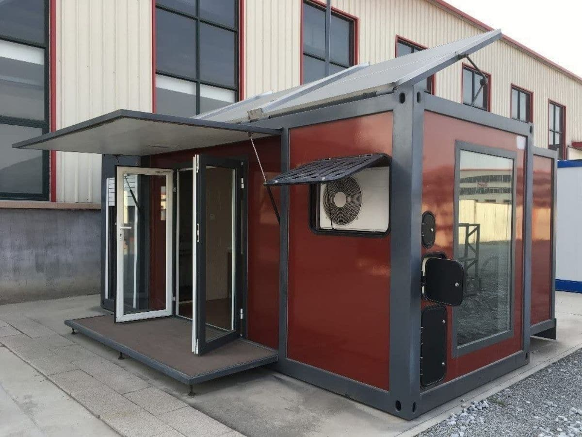 Maroon and black tiny home in parking lot