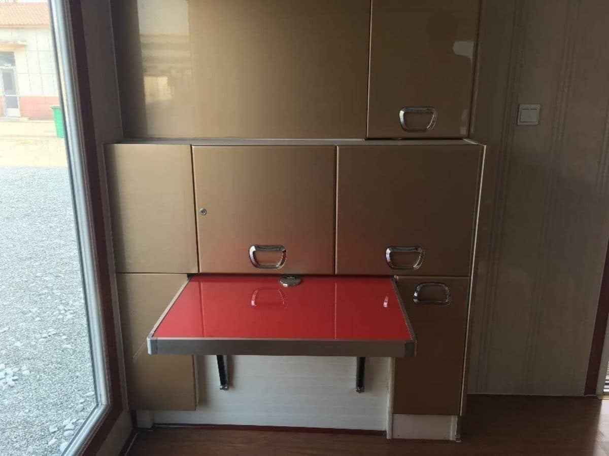 Kitchen with red table propped up