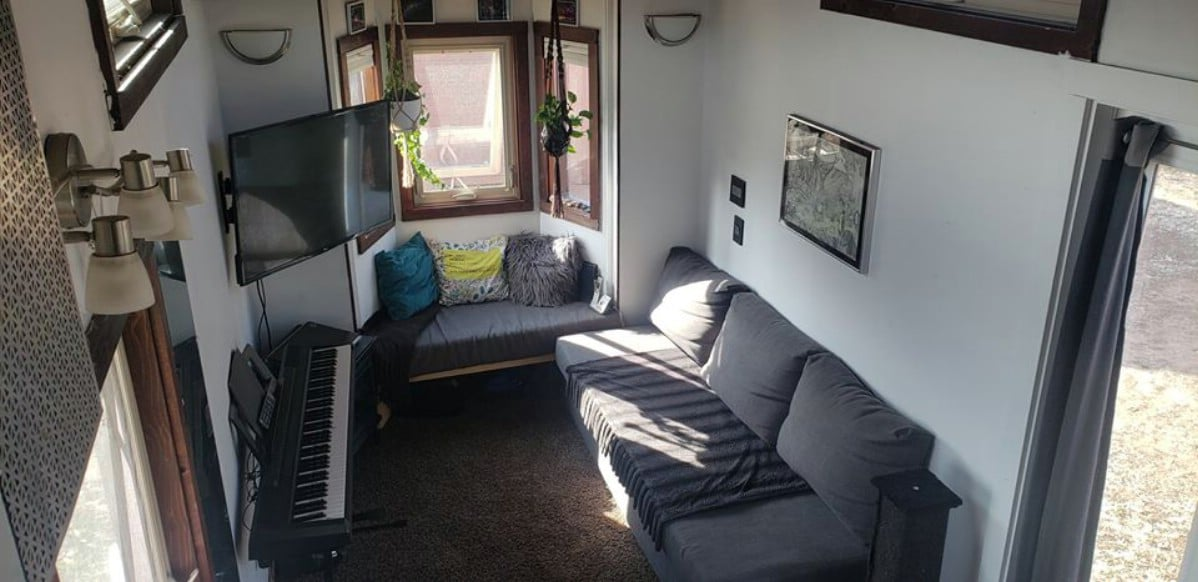 Tiny home living room with couch and keyboard