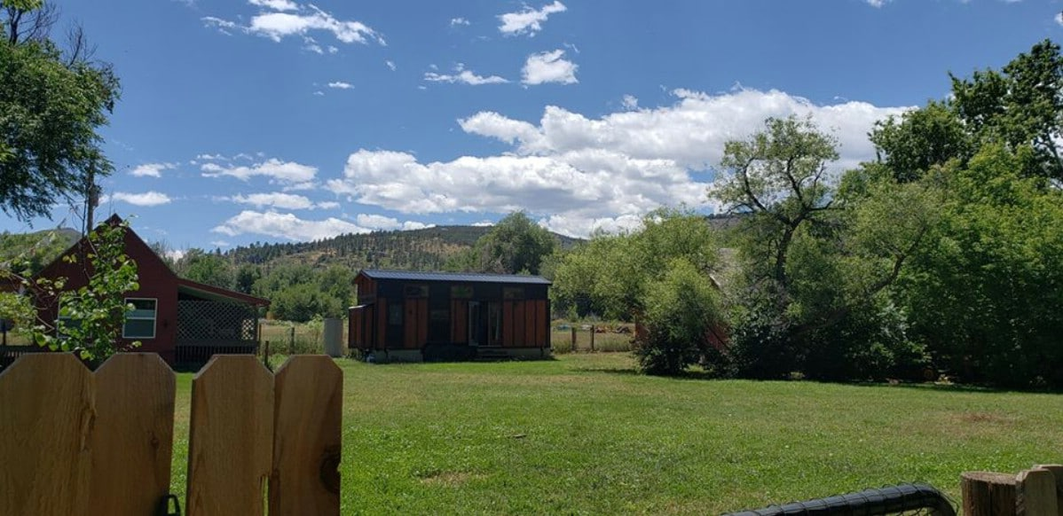 View of mountains behind tiny house