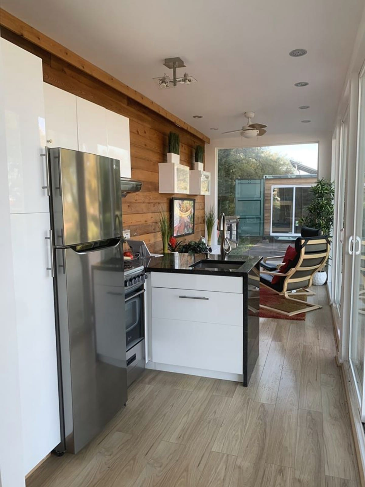 Stainless steel refrigerator and stove in tiny home