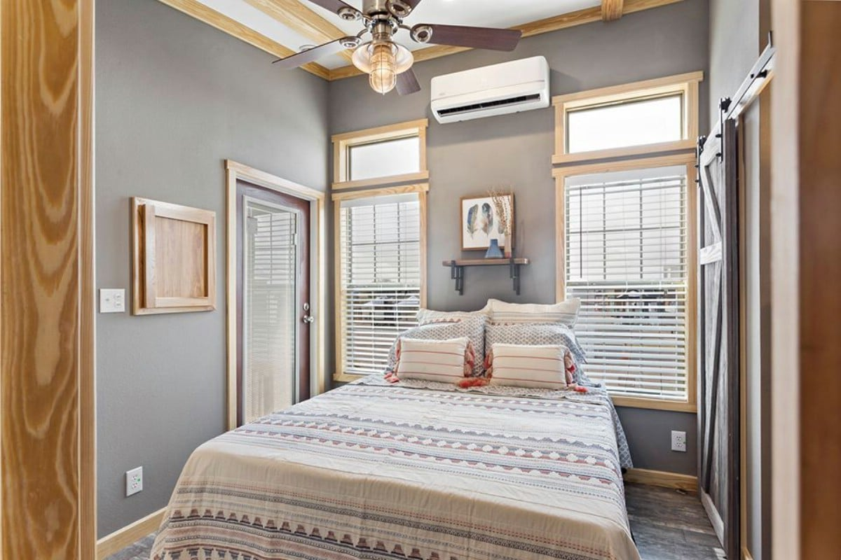 Blonde wood trimmed bedroom with grey paint