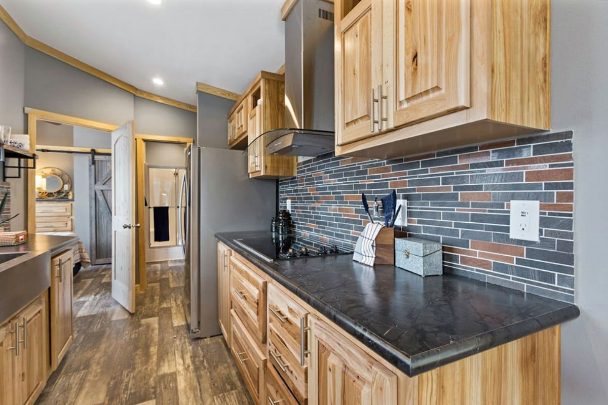 Kitchen with grey stone backsplash