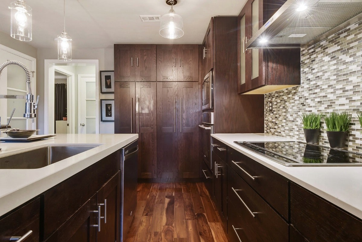 Kitchen stove and mahogany cabinets
