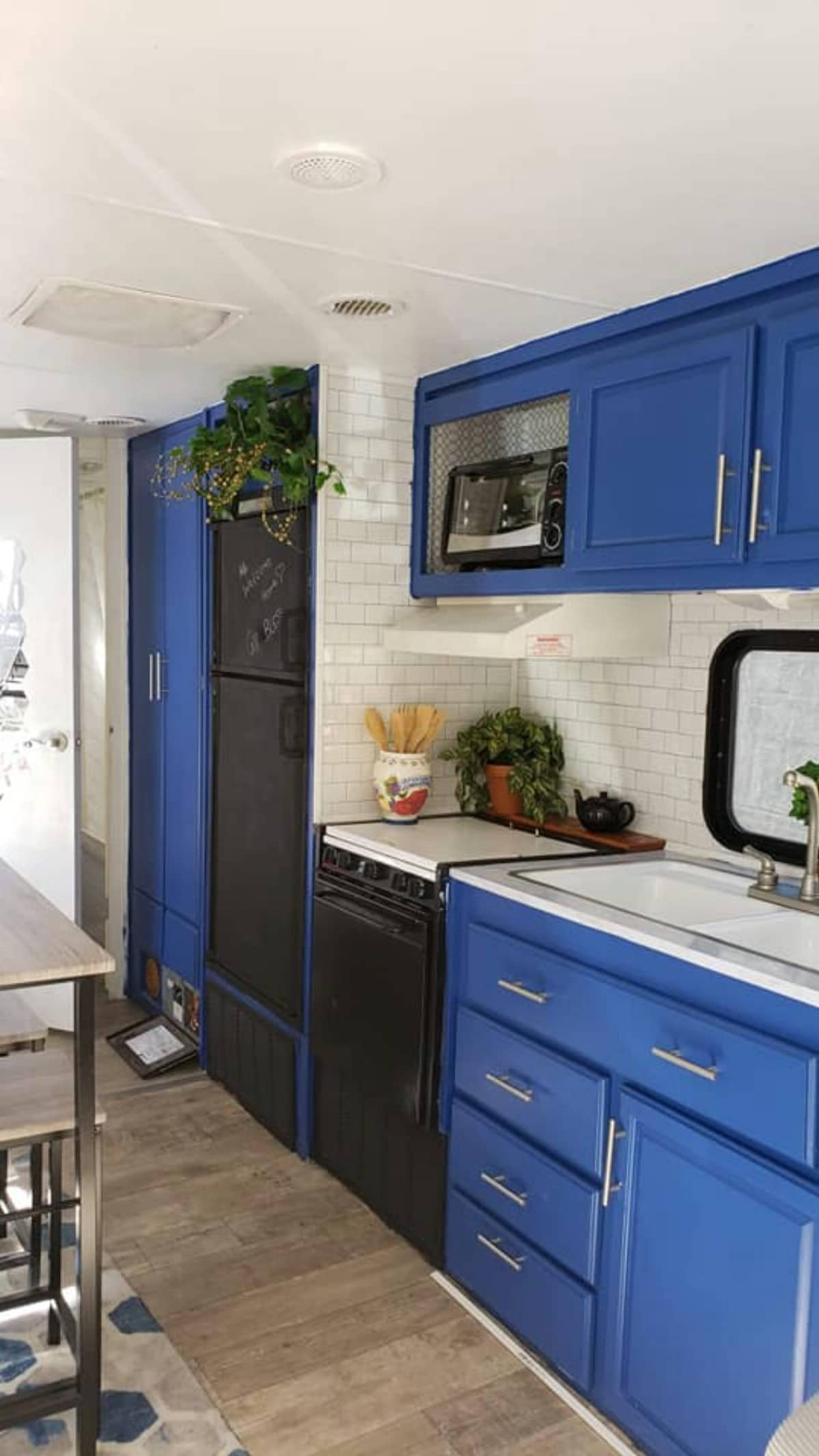 Blue kitchen cabinets with full stove and sink