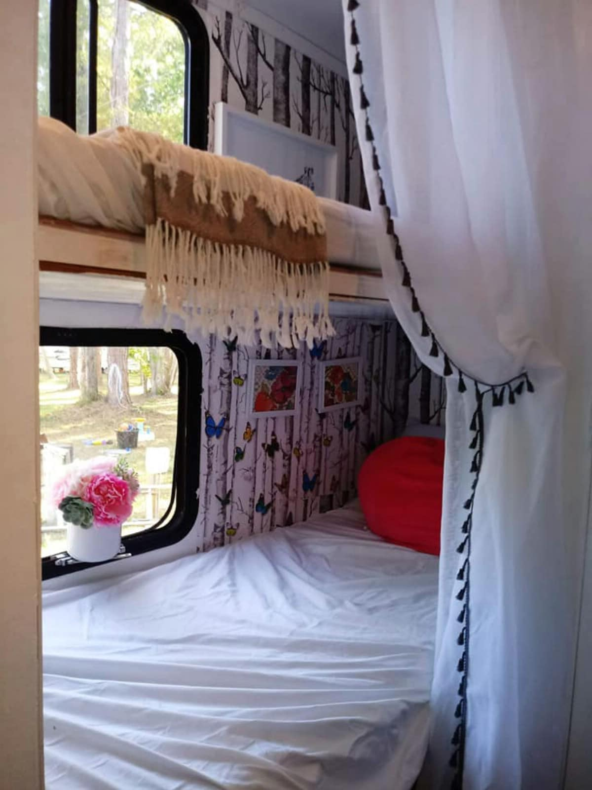 Camper bunk with window and curtains