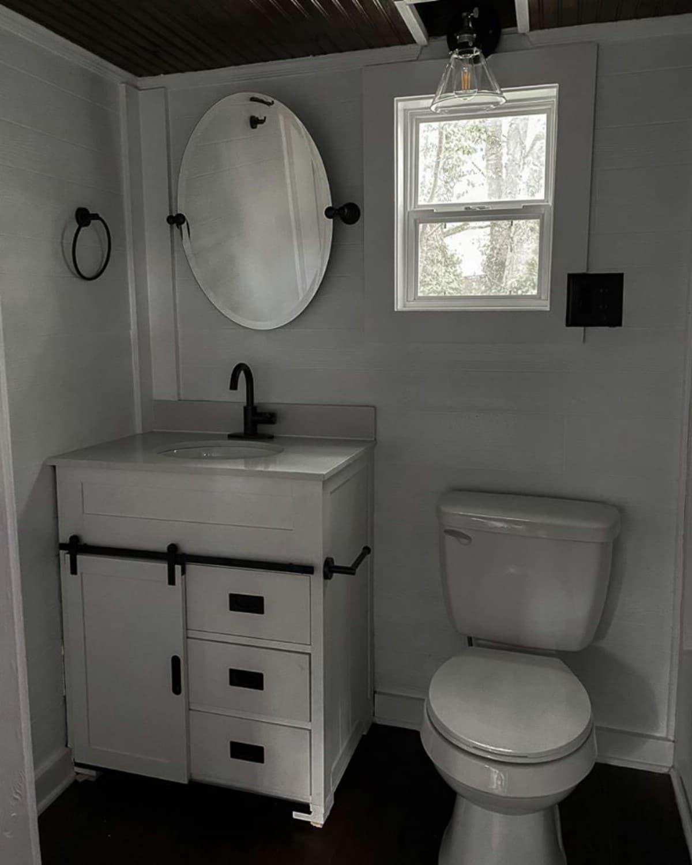 Rustic farmhouse bathroom in tiny house
