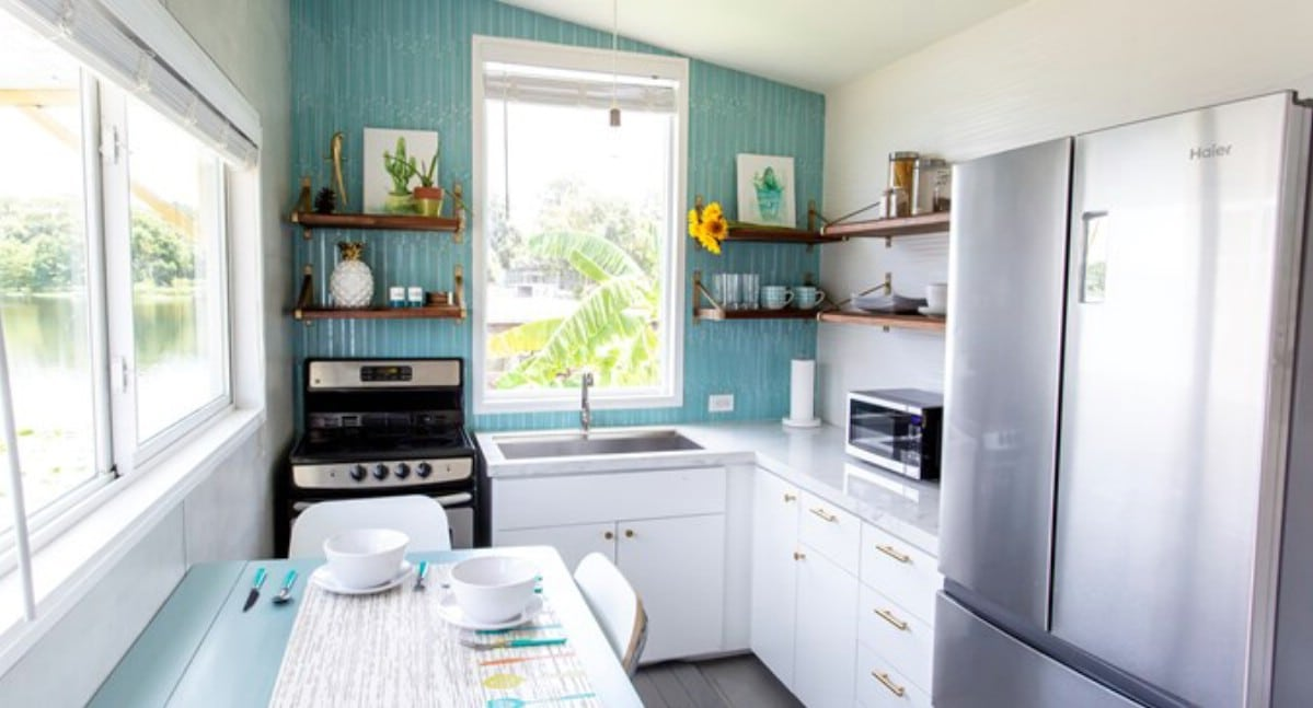 Tiny house kitchen with blue wall