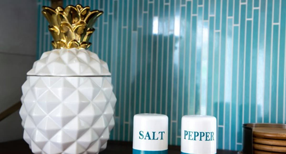 Cookie jar and salt and pepper shaker on counter