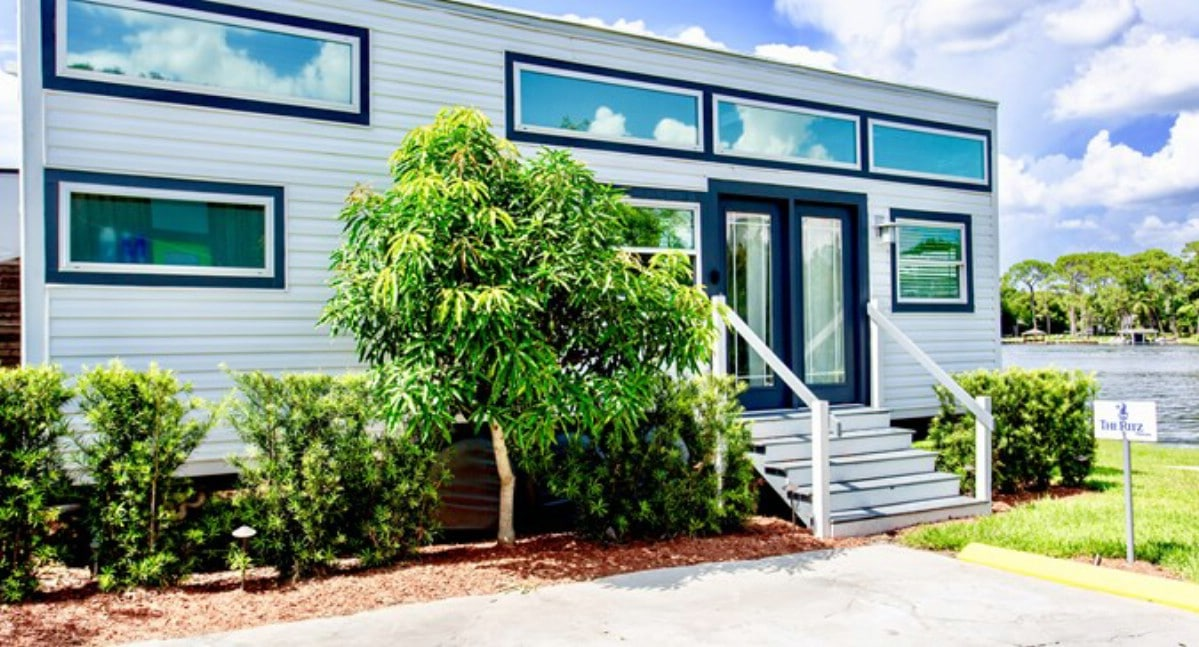 The Ritz tiny house with green shrubs