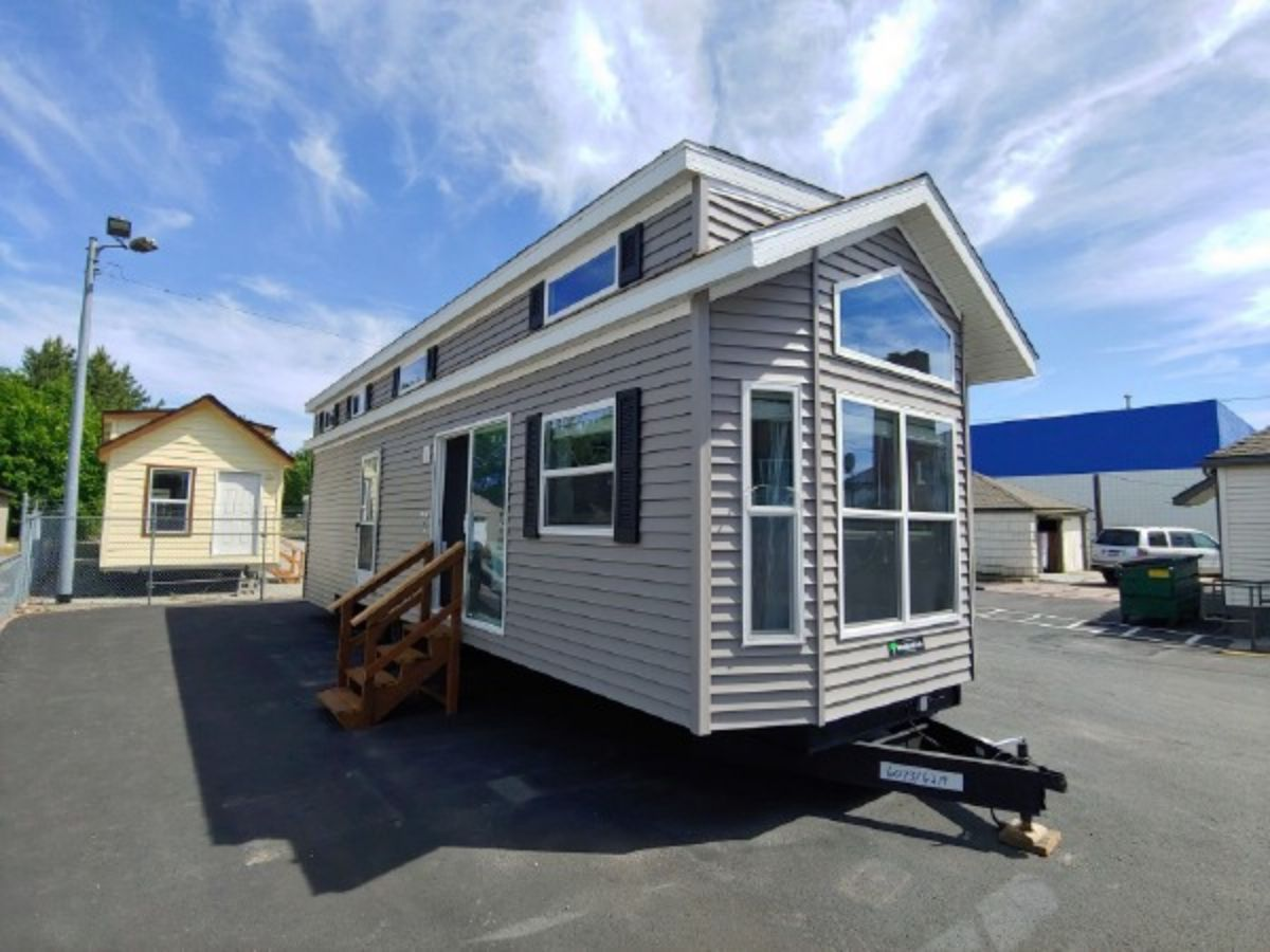 Park Model Homes Tiny House With Ample Storage in the Downstairs Bedroom