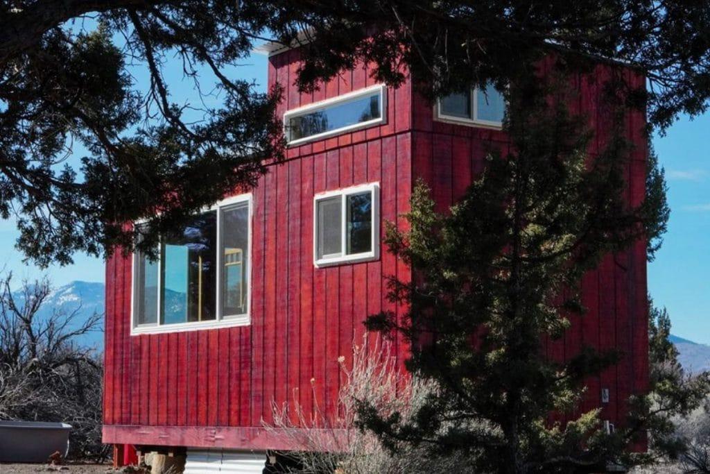 Artisan Tiny House behind trees