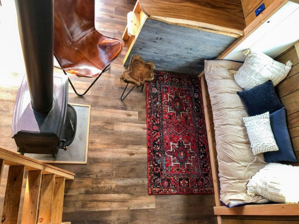 Loft view of living space with red rug