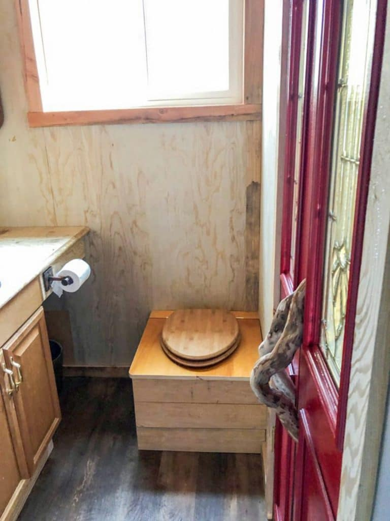 Compost toilet with wood base