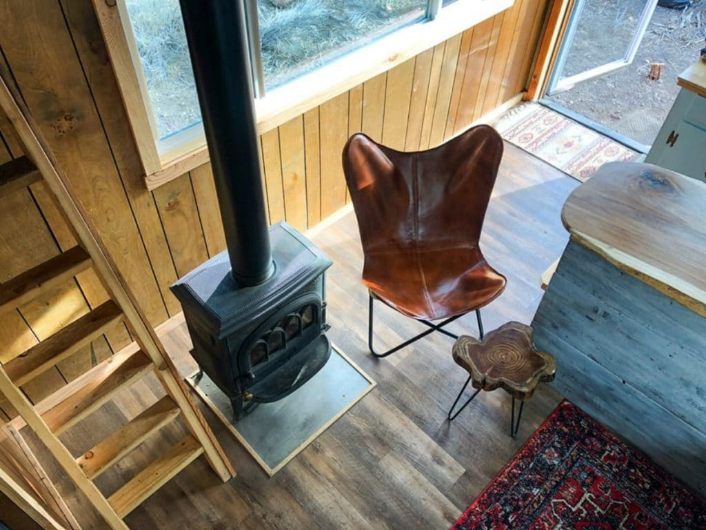 Leather camp chair by wood stove