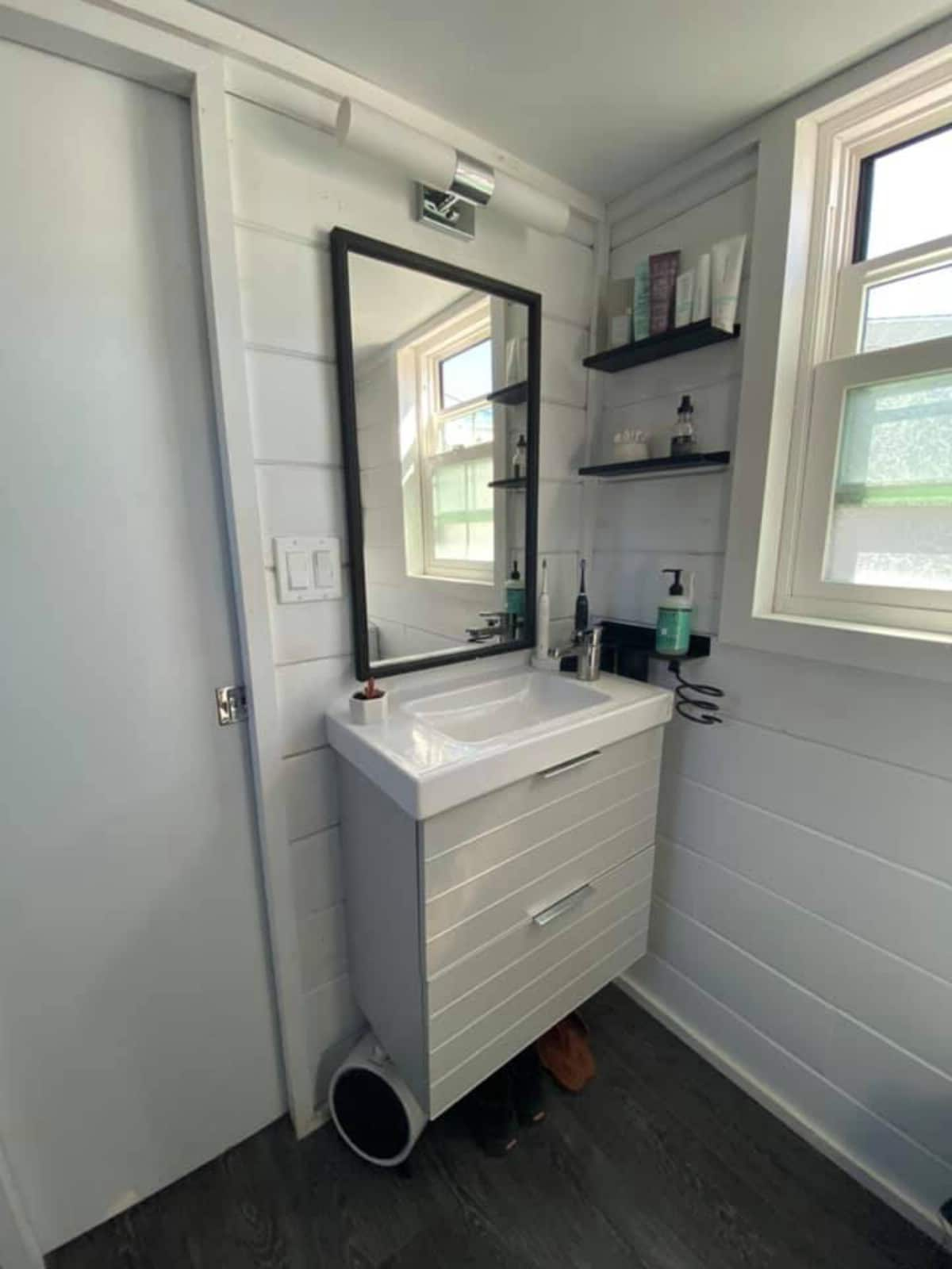 Vanity with large rectangle mirror in tiny home