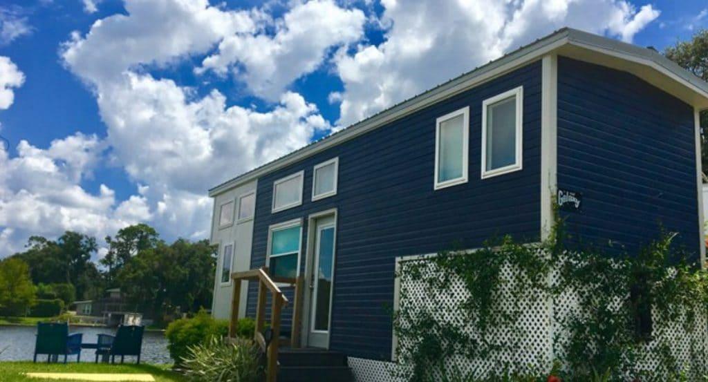 Blue tiny house with white trim