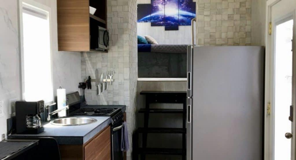 Kitchen view into loft bedroom