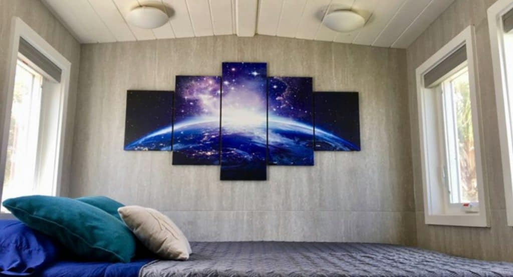 Galaxy themed decor on wall in loft bedroom