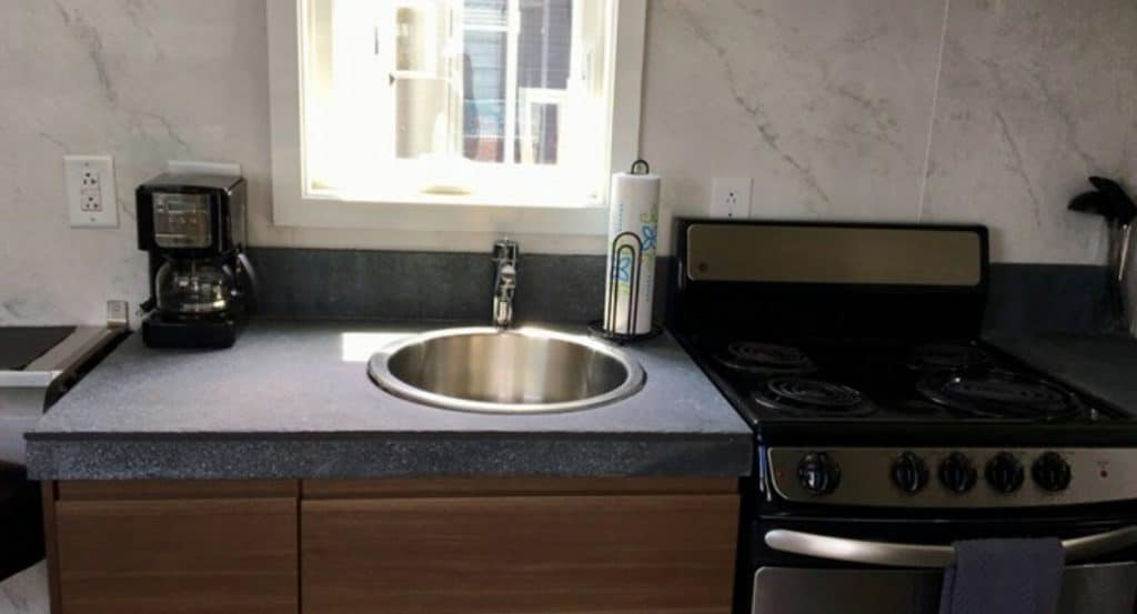 Round kitchen sink and grey counters