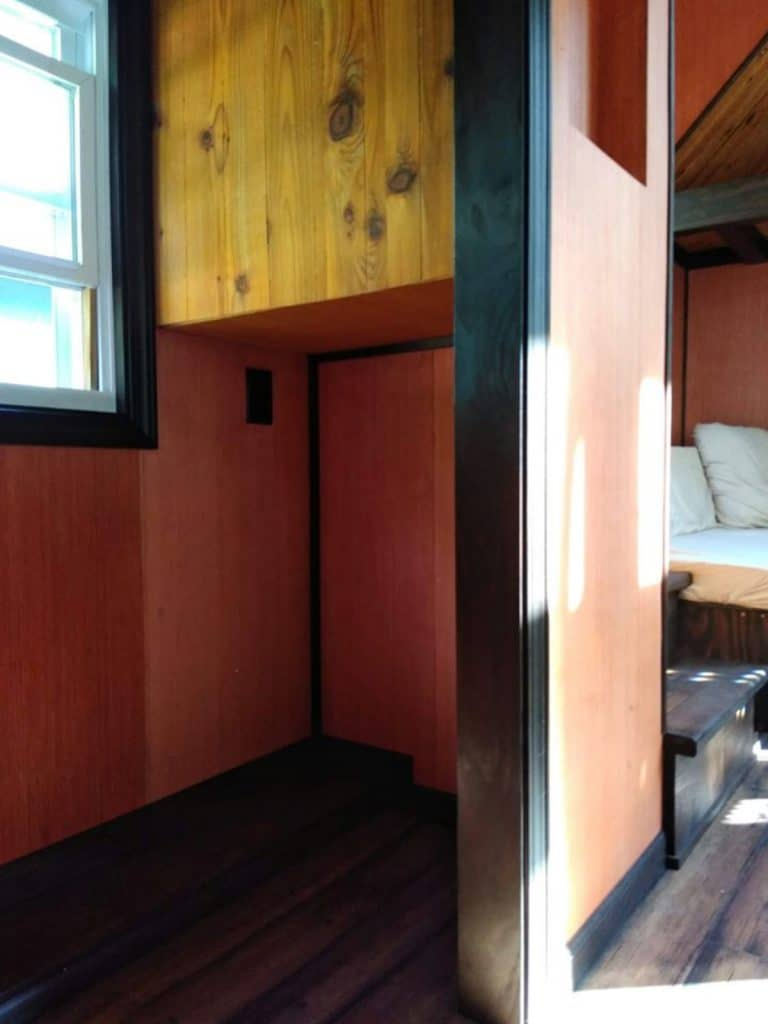 Loft closet space in cabin tiny home