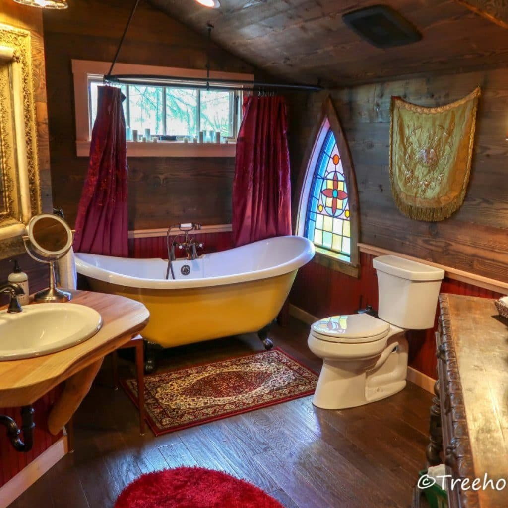 Bathroom with claw tub in treehouse