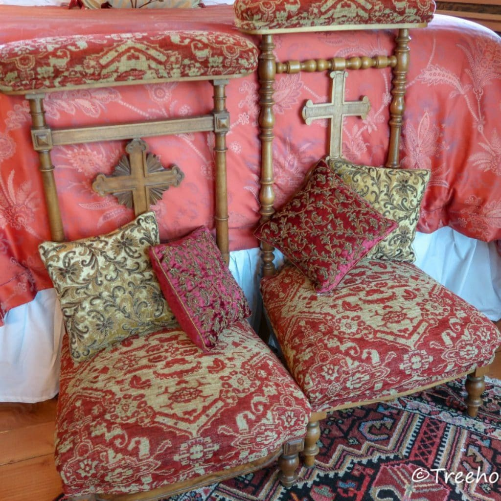 Chairs at the foot of the bed