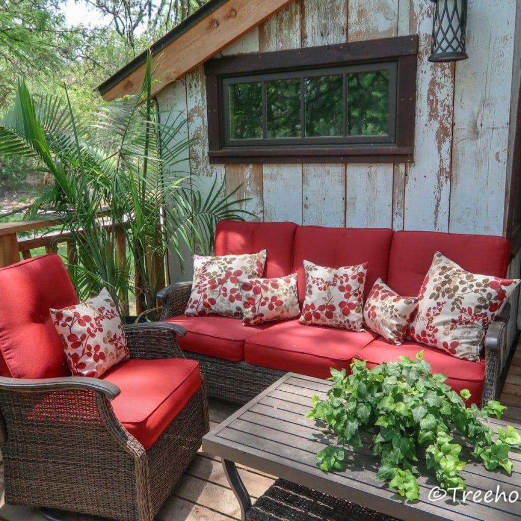 Red furniture on treehouse deck