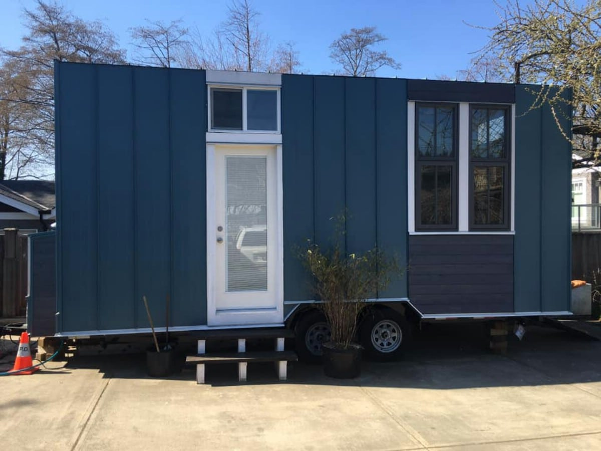 Small blue tiny house on wheels