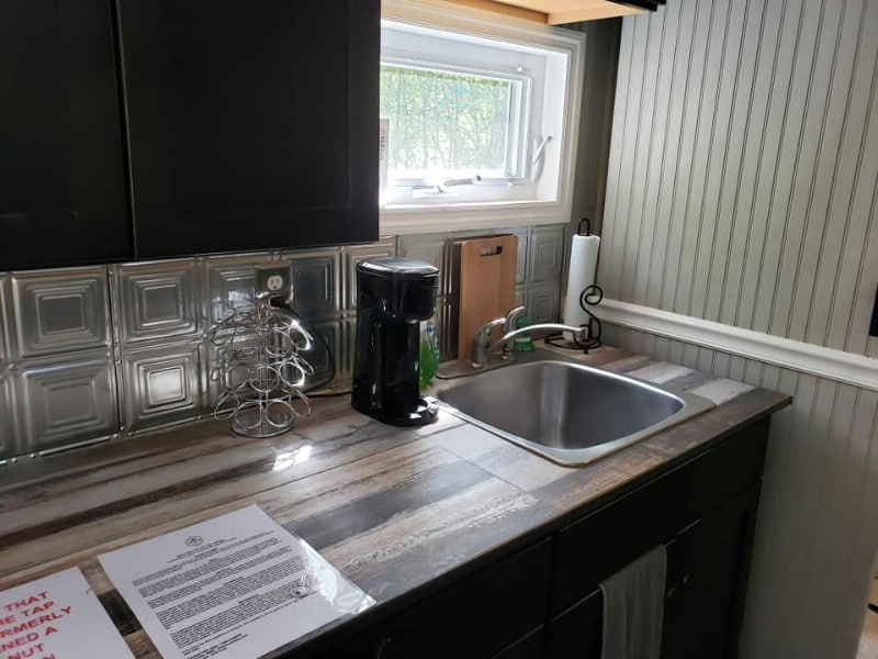 Wood counter and large sink in tiny cabin