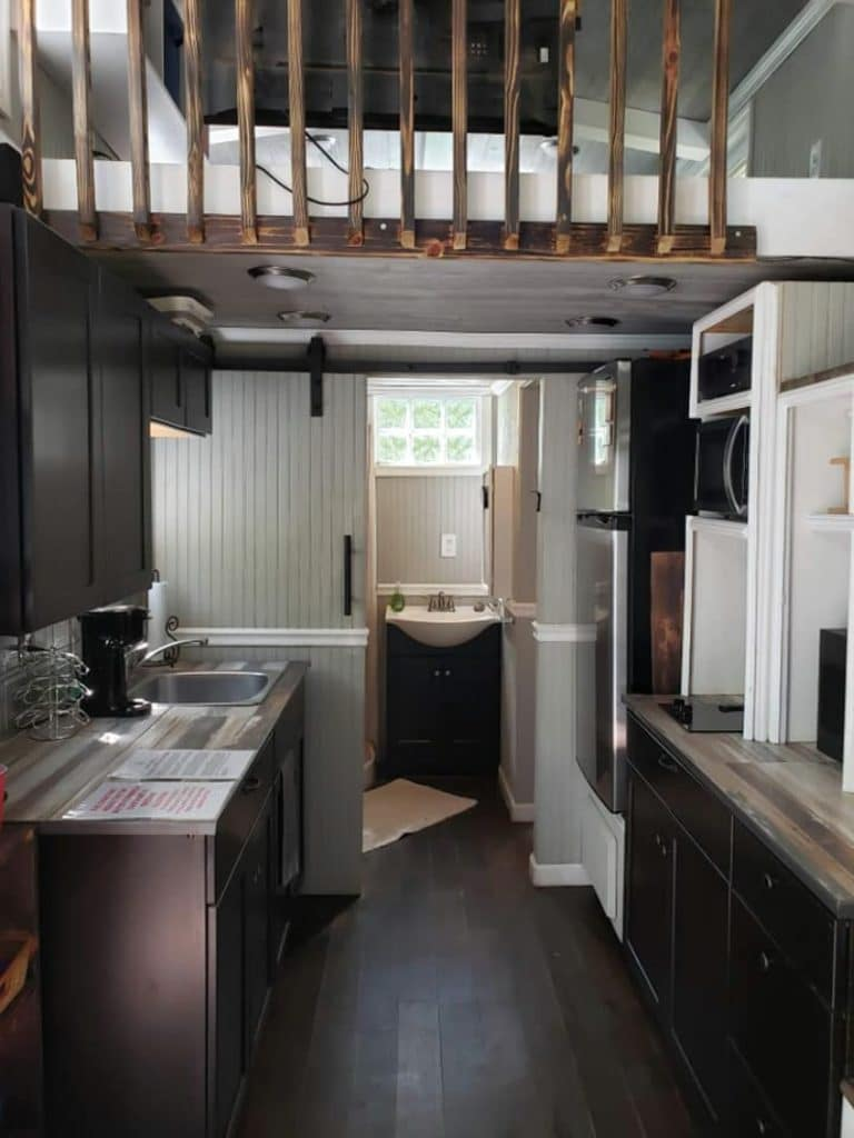 View into kitchen of modern cabin tiny home