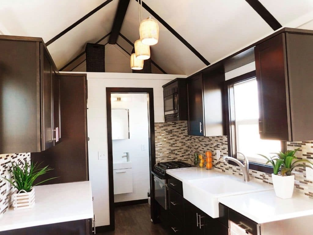 Tiny home kitchen with dark cabinets