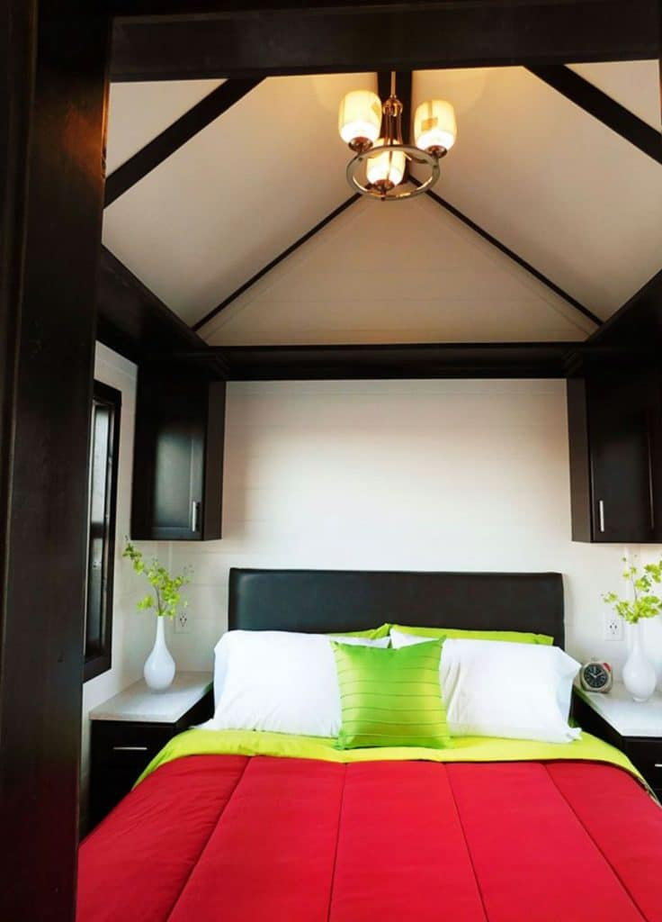 Tiny home bedroom with red bedding