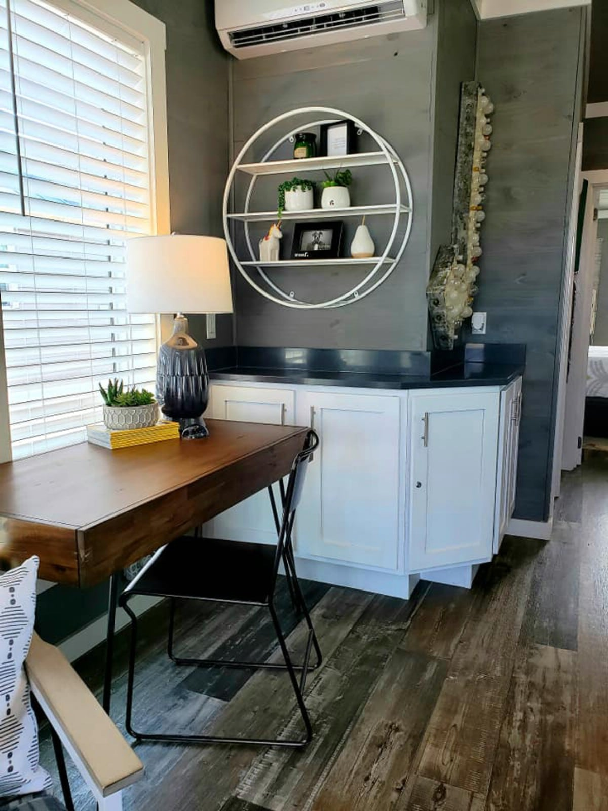 Dining table with round shelf on wall