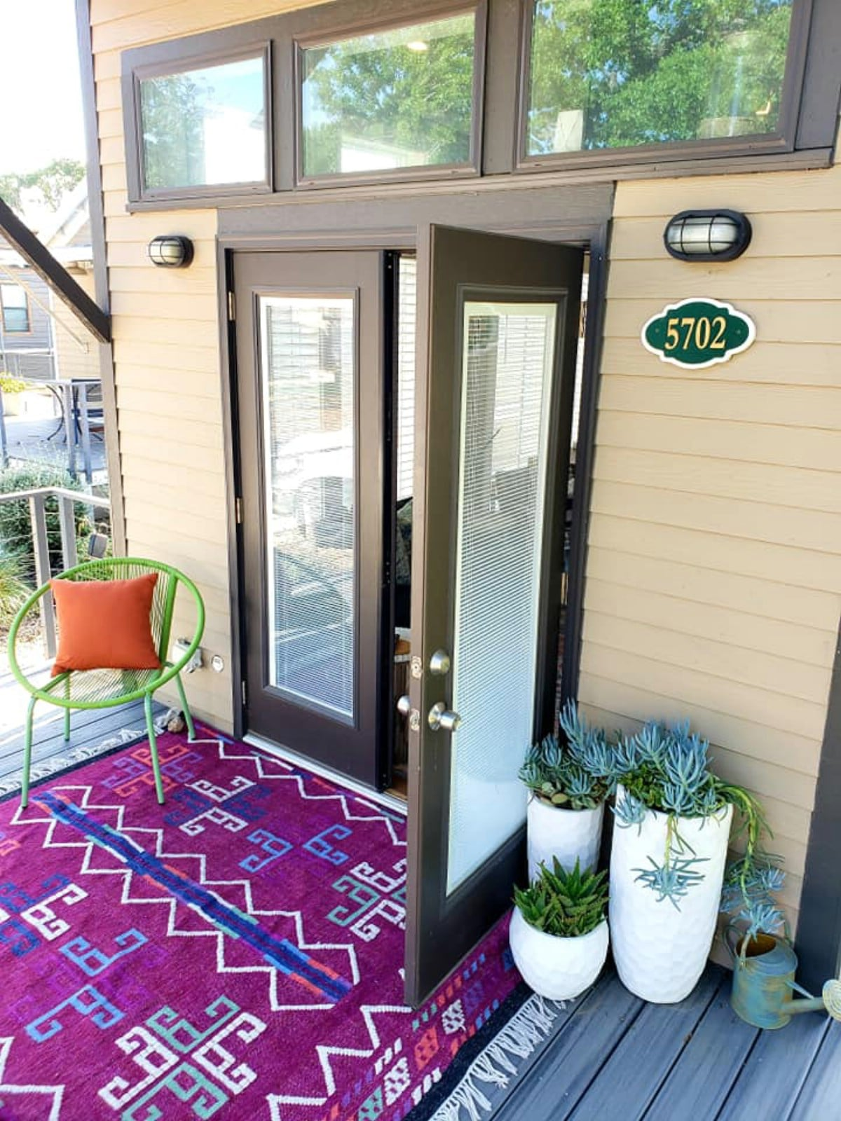 Open doors on porch of tiny home